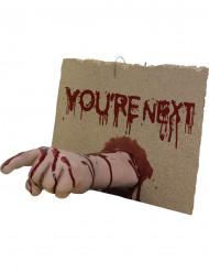 Schild You're next mit abgetrennter Hand