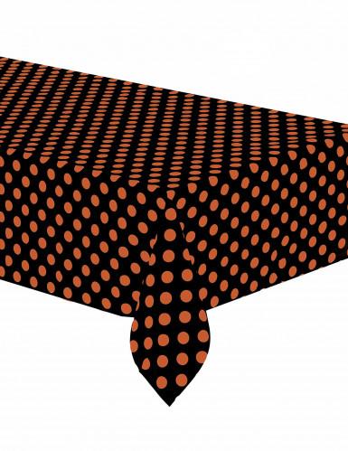 Schwarze Tischdecke mit orangen Tupfen