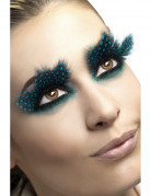 Lange schwarze Wimpern mit blauen Punkten